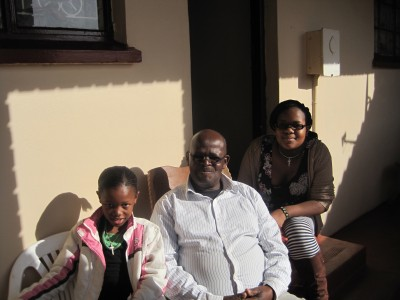 Kalipile Gaxamba with his granddaughters Vuyisa and Lungisa in New Brighton last July. (Photo: Eryn Rosenthal)
